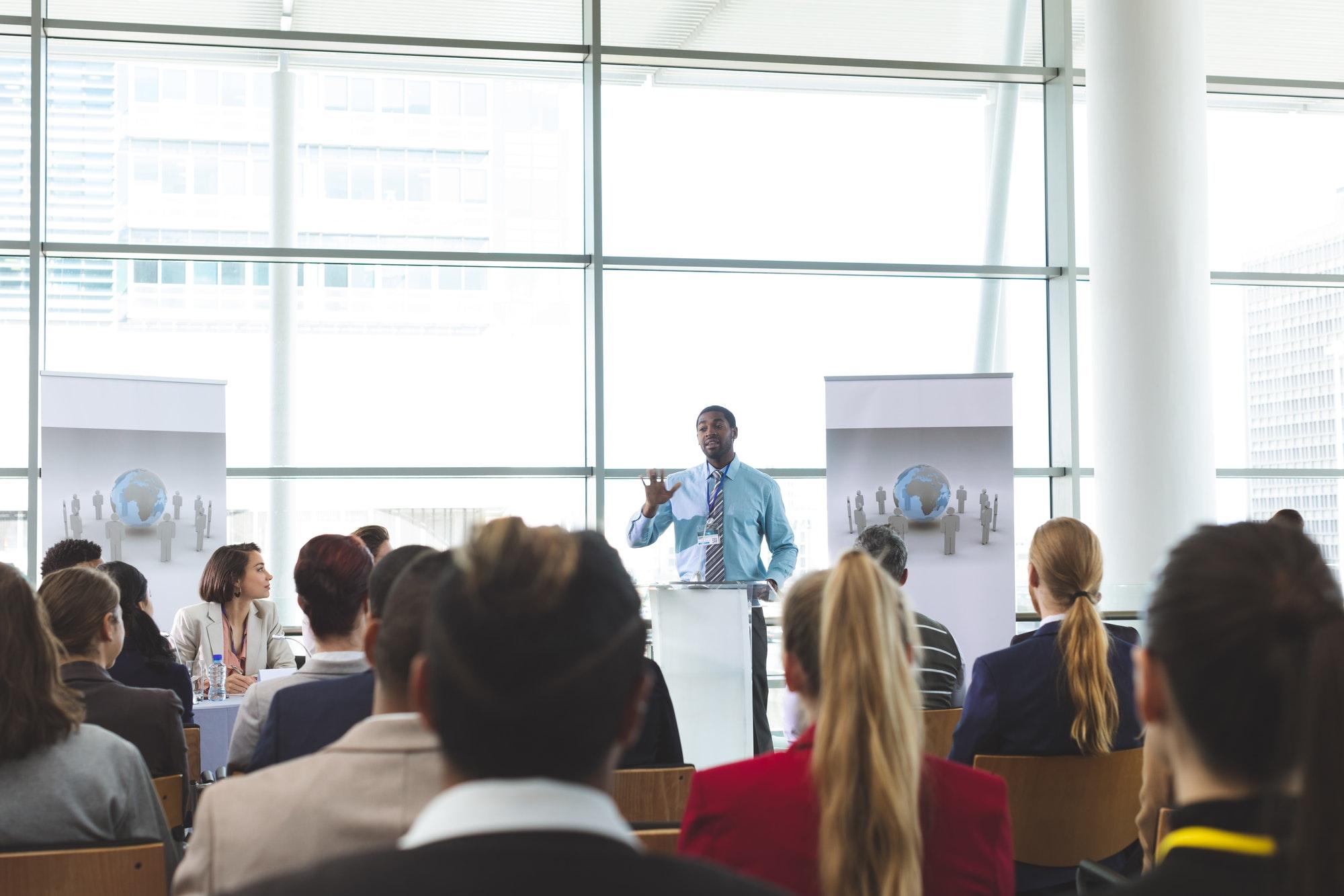 Businessman speaker speaking in a business seminar in office