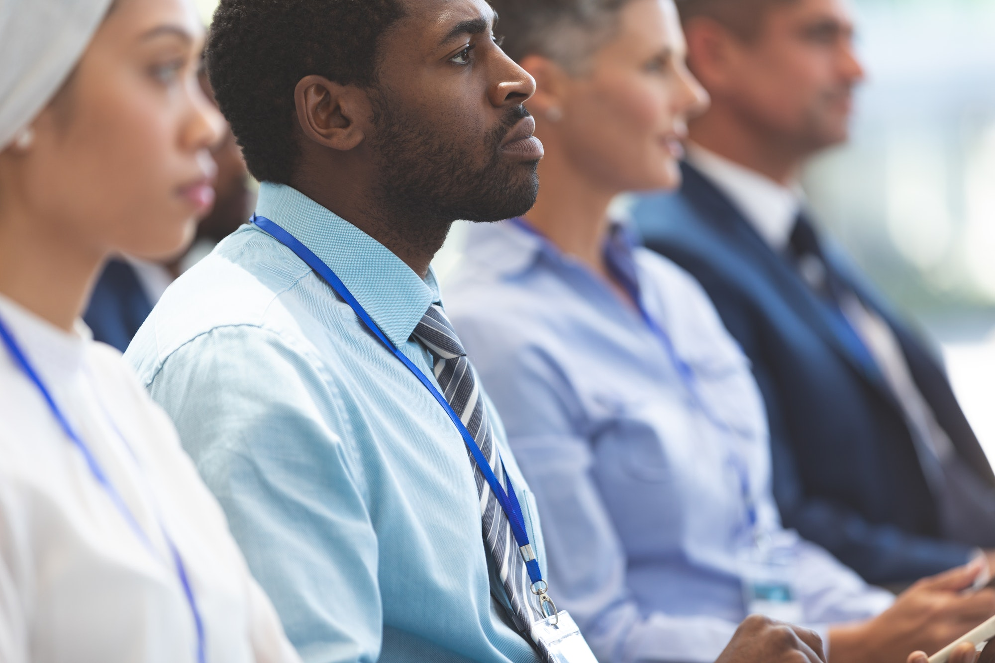 Side view of African american businessman attending a business seminar in office building